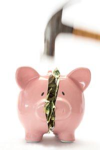 Piggy bank being broken with a hammer